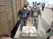 عکس | جاسازی  ۳۲۰ کیلو هروئین در پاکتهای سیمان