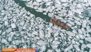 عکس | تصویر هوایی از بندرگاه یخزده در چین