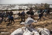 تصاویر | تلاش نیروهای مردمی برای بستن سیلبند رفیع