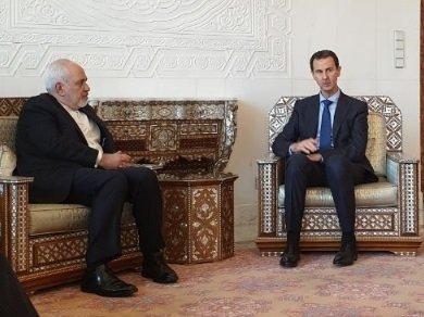 استقبال گرم اسد از ظریف/ عکس