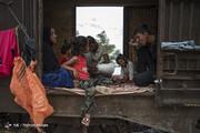 تصاویر | زندگی سیلزندگان خوزستانی در قطار متروکه!