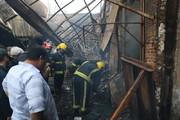 تلاش آتشنشانان برای پاکسازی بازار تبریز بعد از آتش سوزی