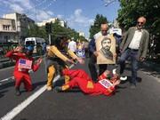 عکس | تابوت اسرائیل در دست راهپیمایان تهرانی/ توریستهای خارجی به حمایت از فلسطین برخاستند/ حواشی راهپیمایی روز قدس