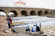 تصاویر | تفریح تابستانی قمیها در کنار رودخانه