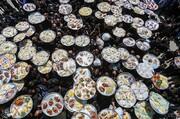 تصاویر | آیین سنتی توزیع نذری در روستای اراضی اصفهان