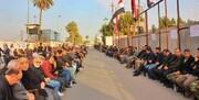 مراسم بزرگداشت شهدای حشد الشعبی در نزدیکی سفارت آمریکا / عکس