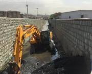 لایروبی کانال زیر بزرگراه همت با ۳۰۰ کامیون