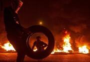 آتشزدن لاستیکها در اطراف فرودگاه نجف اشرف/ عکس