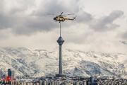 ببینید | تقارن دیدنی هلیکوپتر با برج میلاد در یک روز برفی
