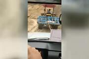 ببینید | تلاش راننده تراکتور برای رساندن صندوق رای به روستای صعب العبور