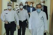 تصاویر |سلام نظامی و دسته گل رئیس پلیس راهنمایی و رانندگی تهران برای پزشکان بیمارستان مسیح دانشوری