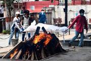ببینید | سوزاندن قربانیان کرونا در هند