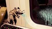 عکس | تبلیغ ماسک در متروی لندن به شیوه بنکسی