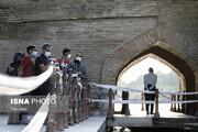 تصاویر | بسته شدن دهانه زیرین سیوسه پل در پی مرگ قهرمان واترپلو