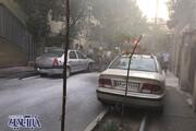 عکس   آتش گرفتن خودرو ال 90 در خیابان لارستانِ تهران