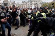 ببینید | درگیری پلیس با معترضان به محدودیتهای کرونایی