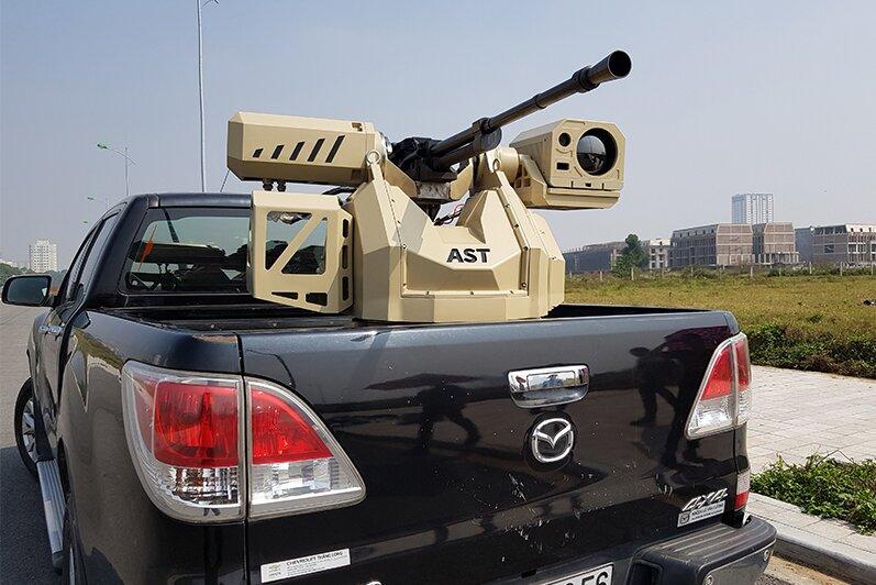 5501024 - شهید فخری زاده با این سلاح نظامی ترور شد/ «تیربار اتوماتیک» چگونه کار میکند؟/ عکس