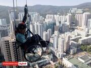 عکس/ صعود یک معلول با ویلچر از برج 320 متری