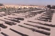 ببینید | لحظه کشف مخفیگاه و انبار سلاح داعش