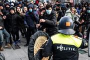 ببینید | درگیری پلیس ضدشورش هلند با معترضان محدودیتهای کرونایی