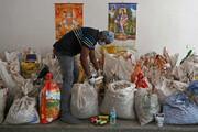 تصاویر | گونیهای حاوی بقایای اجساد فوتیهای کرونایی در هند
