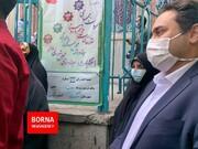 عکسی از دختر و داماد روحانی در صف رای حسینیه ارشاد