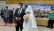 ببینید | حضور عروس و داماد کرجی پای صندوق رای