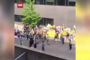 ببینید | حمله منافقین ساکن سوئد به رایدهندگان ایرانی