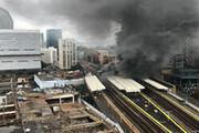 ببینید | آتشسوزی مهیب و انفجارهای پیاپی در ایستگاه قطاری در لندن