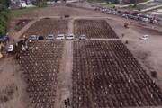ببینید   تصاویری وحشتناک از تدفین شبانهروزی قربانیان کرونا در اندونزی
