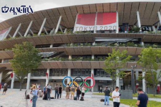 ببینید   نمایی از ورزشگاه بدون تماشاگر توکیو ساعاتی قبل از افتتاحیه