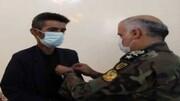 نشان فداکاری ارتش به خانواده شهید «علی لَندی» اهدا شد